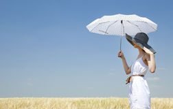 Girl at spring field with umbrella. Royalty Free Stock Photography