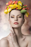 Girl with spring floral garland Stock Image