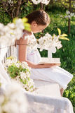 Girl with spring flower Stock Photos