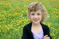 Girl in Spring Flower Field Royalty Free Stock Photos
