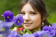 Girl with spring flowers Royalty Free Stock Photos