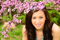 Girl in Spring flowers Stock Photos