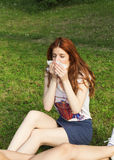 Girl with spring flu. Outdoor Royalty Free Stock Photography