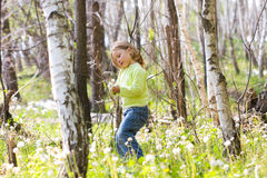 Girl in spring forest Royalty Free Stock Image