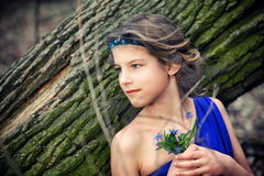Girl in spring forest Royalty Free Stock Photography