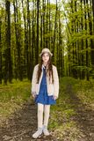 Girl in the spring forest Stock Image