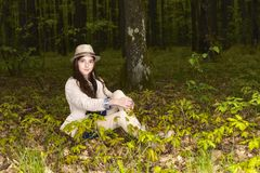Girl in the spring forest Stock Photos