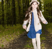 Girl in the spring forest Stock Photography