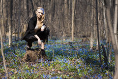 The girl in the spring forest. Snowdrops in their hair, a fabulous image Stock Photography