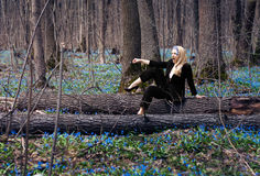 The girl in the spring forest. Snowdrops in their hair, a fabulous image Stock Photo