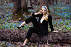 The girl in the spring forest,. Snowdrops in their hair, a fabulous image, business girl style, original style Royalty Free Stock Image