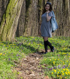 Girl in spring forest stock photo