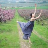 Girl in spring garden Stock Image