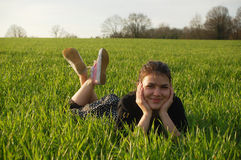 Girl in spring grass Royalty Free Stock Image