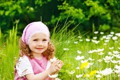 Girl on spring meadow Royalty Free Stock Photos