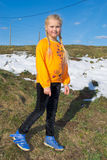Girl in spring sunny day walking in the meadow Stock Images