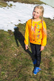 Girl in spring sunny day walking in the meadow Stock Photography