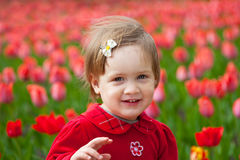 Girl in spring tulips plant Royalty Free Stock Image