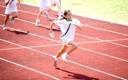 Girl sprints towards the finishing line. Royalty Free Stock Image