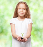 Girl with sprout Stock Photography