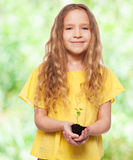 Girl with sprout Stock Images