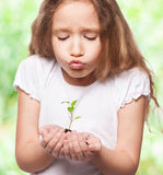 Girl with sprout Royalty Free Stock Image