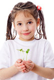 Girl with sprouts in hands Stock Images