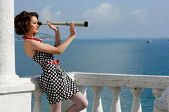 Girl with spyglass Royalty Free Stock Images