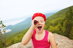 Girl with spyglass Royalty Free Stock Photography