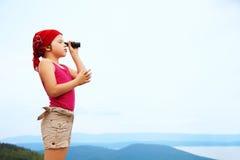 Girl with spyglass Stock Photo