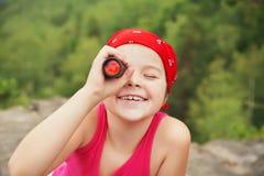 Girl with spyglass stock image