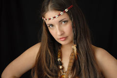 Girl squaw. The girl in ethnic American Indian ornaments Stock Images