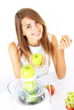 Girl Squeezes The Juice From The Juicer Stock Photo