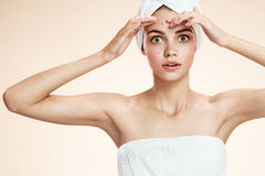 Girl squeezing her pimples, removing pimple from her face. Woman skin care concept royalty free stock photos
