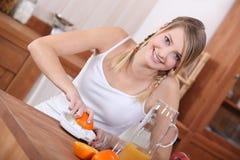 Girl squeezing orange juice Royalty Free Stock Image