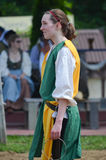 Girl Squire at Renaissance Festival. Young female squire helping jousters of Noble Cause Productions at the St. Louis Renaissance Faire Royalty Free Stock Images