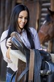 Girl in stable. Pretty young girl in the stable Stock Photo