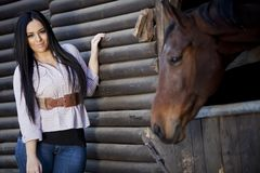 Girl in the stable Royalty Free Stock Images