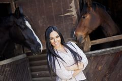 Girl in the stable Stock Image