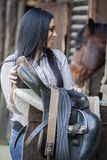 Girl in the stable Stock Photography