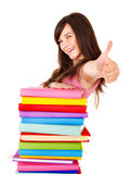 Girl with stack book showing thumb up. Stock Images