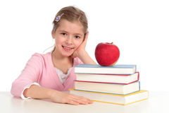 Girl with Stack of Books Royalty Free Stock Photo