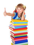 Girl with stack of books and showing thumb up. Royalty Free Stock Photo