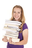 Girl stack of books smile Stock Images