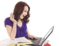 Girl with stack color book  and laptop. Royalty Free Stock Photos