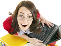 Girl with stack color book  and laptop. Royalty Free Stock Image
