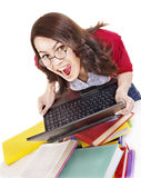 Girl with stack color book  and laptop. Stock Photo