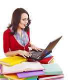 Girl with stack color book  and laptop. Stock Photos