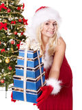 Girl stack  gift box by christmas tree.. Stock Photography