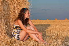 Girl in stack of hey Royalty Free Stock Images